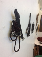 Not sure what to call these black mixed media pieces...