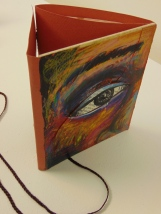 Folded book, wrap-a-round cover Colored pencil, pen, hair, paper, found object 2014