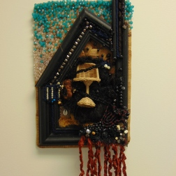 Hair, pony beads, wooden picture frame, woven mat, found objects 2014