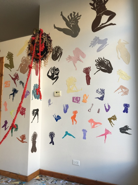 Right wall of cut out figures and hanging assemblage